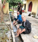 Helen and Chris cleaning up after irrigating the field. Photo: Manish.