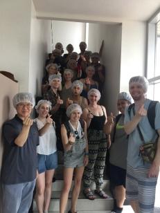 Hair nets to keep the organic tofu production line uncontaminated at Hansalim.