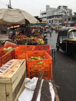 Market vendors and auto-rickshaws.