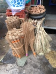 Different types of hand-made brooms.