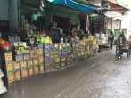 Vendors selling different types of cooking oils.