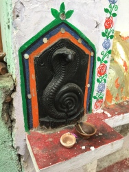 Small temple to Lord Shiva on a street wall.