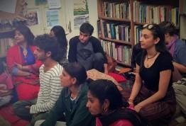 Alex and Sebastian listen on with members of the Shikshantar community.