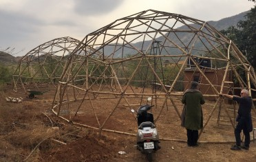 Frames for geodome buildings under construction.